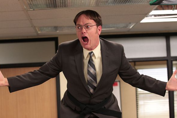 dwight-on-table-screaming-the-office